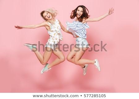 Dois sorridente loiro morena moça bonita Foto stock © bartekwardziak