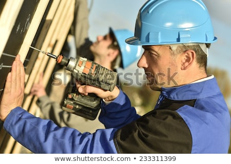 Construction workers using a tool Stock photo © photography33