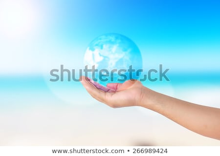 crystal globe and hands Stock photo © prill