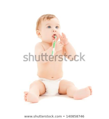 Kleinkind · wenig · grünen · Zahn - stock foto © dolgachov
