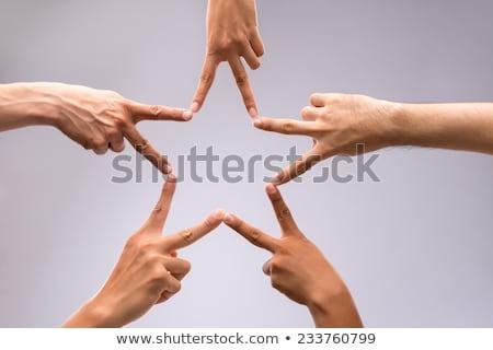 Mãos trabalho em equipe estrela forma abstrato projeto Foto stock © oly5