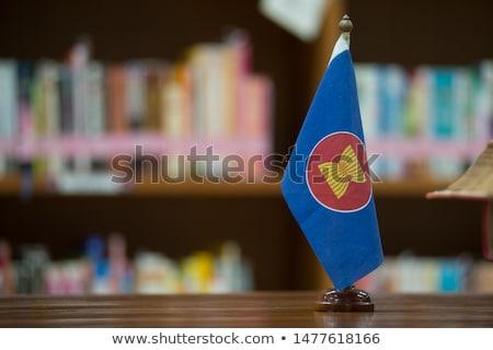 Cambodia Small Flag on a Map Background. Stock photo © tashatuvango