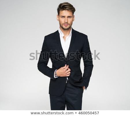 Férfi modell öltöny nyakkendő sötét arc férfi Stock fotó © vanessavr
