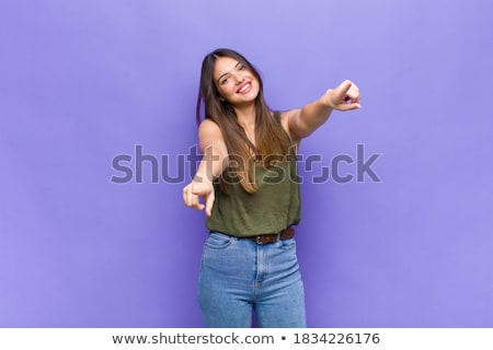 Young woman pointing towards camera with both hands Stock photo © bmonteny