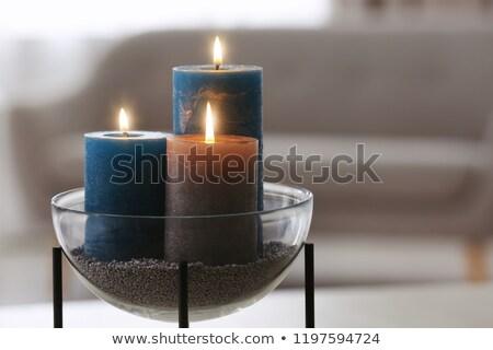 burning candle on a blur background stock photo © mikhail_ulyannik