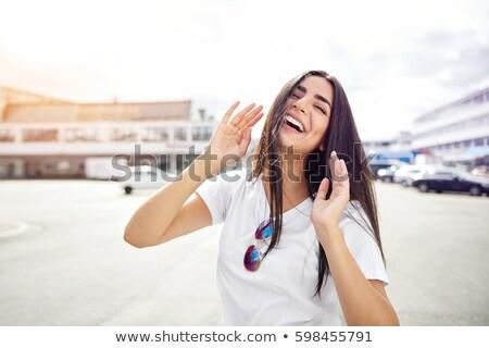Cute vivacious woman in sunglasses Stock photo © stryjek