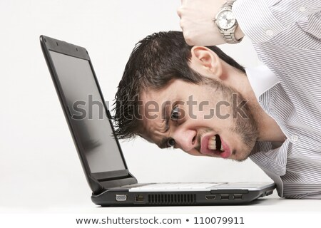 Angry young businessman at office Stock photo © wavebreak_media