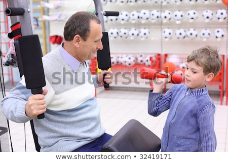 boy in shop on  sports exerciser Stock photo © Paha_L