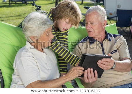 surfer man with pc tablet stock photo © deandrobot