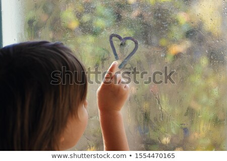 abstract childrens drawing water color paints on glass stock photo © zurijeta