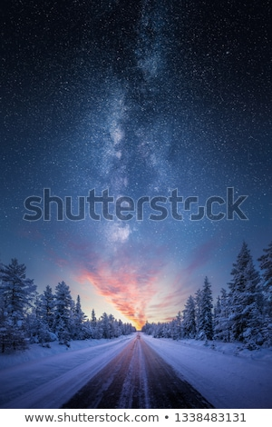 Snow covered road and polar lights Stock photo © ssuaphoto