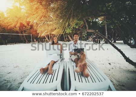 ifjú · pár · pihen · tengerpart · romantikus · fiatal · pér · ül - stock fotó © dariazu