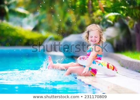 Gyönyörű kislány kék úszik öltöny színes Stock fotó © Traimak