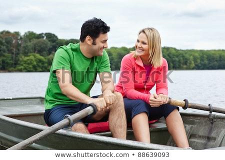 Középkorú pár evezős csónak férfi természet mosolyog Stock fotó © IS2