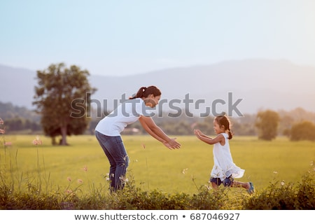 Mother and daughters running in garden Stock photo © IS2