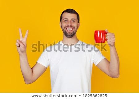 Portré fiatalember tart kettő ujjak felfelé Stock fotó © IS2