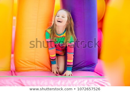 Children bouncing on trampoline Stock photo © IS2