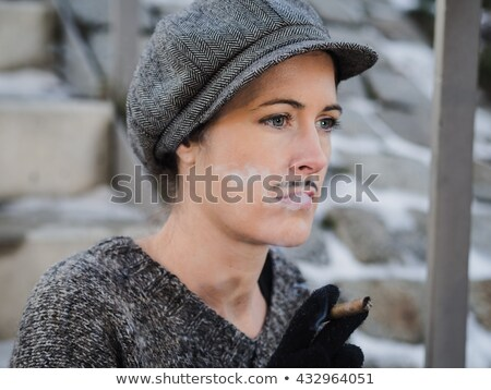 Androgynous man smoking a cigar Stock photo © wavebreak_media