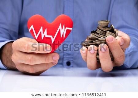 Férfi tart szív pulzus gyakoriság arany Stock fotó © AndreyPopov