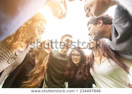 group of young cheerful multiethnic men stock photo © deandrobot