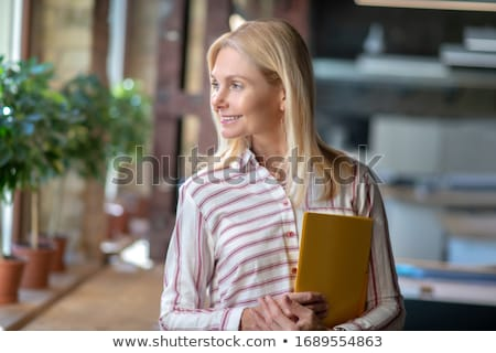 Woman in shirt with big folder Stock photo © Traimak