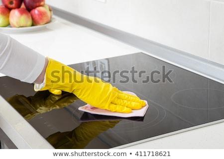 Donna pulizia stufa tovagliolo primo piano Foto d'archivio © AndreyPopov