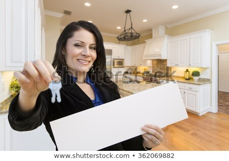 Hispanic Woman With House Keys and Blank Sign In Empty Room of H Stock photo © feverpitch