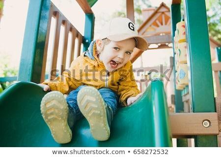 jongen · swing · gelukkig · glimlachend · park · speeltuin - stockfoto © galitskaya
