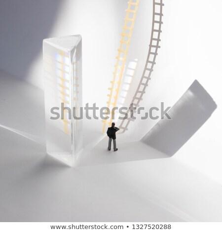 Stockfoto: Small Business Man Climbing Looking At A Big Business Man
