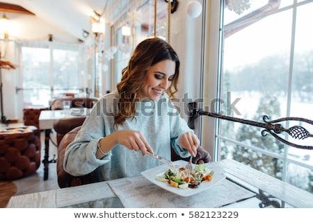 Gülümseyen kadın restoran insanlar lüks gülen genç kadın Stok fotoğraf © dolgachov