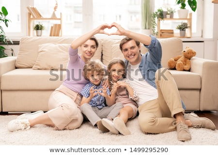 Happy parents and two adorable siblings making heart shape with fingers Stock photo © pressmaster