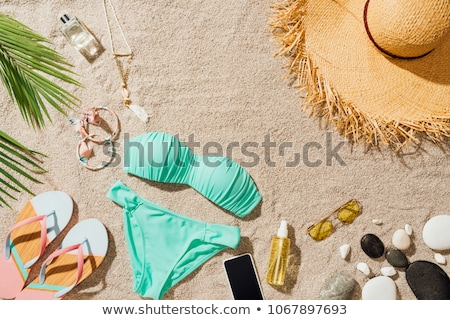 smartphone and flip flops on beach sand Stock photo © dolgachov