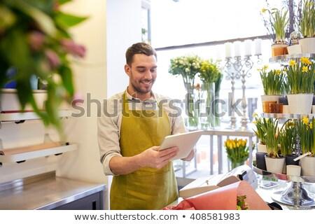 Virágárus férfi eladó virágüzlet pult vásár Stock fotó © dolgachov