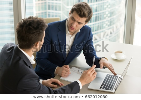two young male analysts discussing new business or financial strategies stock photo © pressmaster