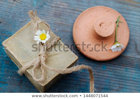handmade olive soap and moroccan clay pumice on blue wooden background - home spa, hammam  Stock photo © laciatek