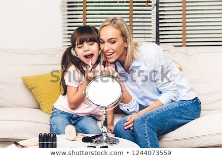 pretty child applying make up stock photo © vladacanon