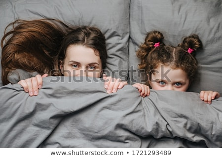 Mom and baby have fun and have fun early in the morning in the room on the bed Stock photo © ElenaBatkova