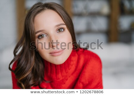 Headshot of attractive healthy European woman with dark hair and soft skin, looks directly at camera Stock photo © vkstudio