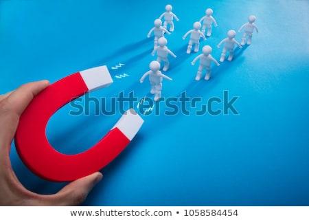 üzletember emberi patkó mágnes közelkép papír Stock fotó © AndreyPopov