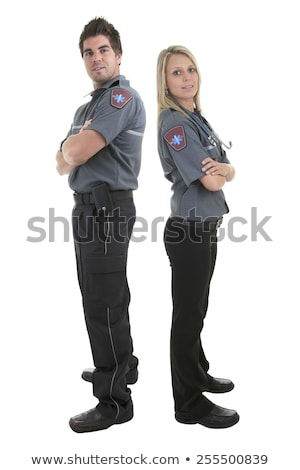Paramedic employee with ambulance in the background. Stock photo © Lopolo