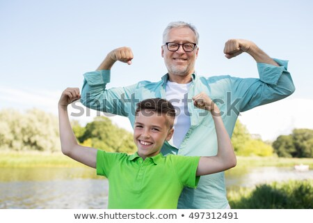 happy grandfather and grandson showing muscles Stock photo © dolgachov