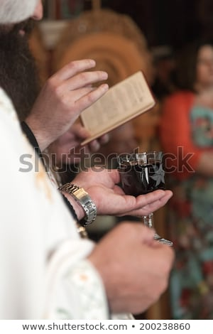 Priest' hands during a wedding ceremony/nuptial mass  Stock photo © lightpoet