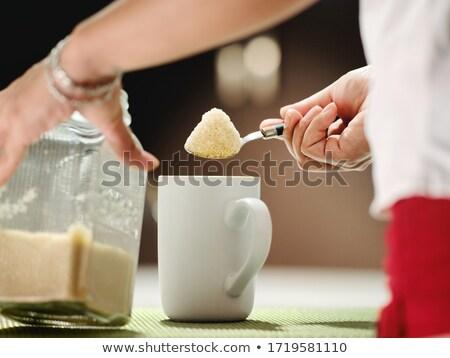 Vrouw suiker theelepeltje koffiemok drinken beker Stockfoto © diego_cervo