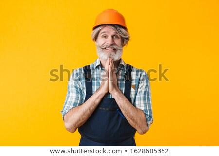 érzelmes idős férfi mutat reményteljes kézmozdulat Stock fotó © deandrobot