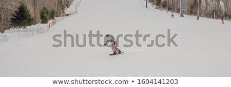 Male snowboarder at a ski resort in winter BANNER, LONG FORMAT Stock photo © galitskaya