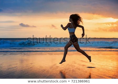 прыжки · девушки · ярко · фотография · счастливым - Сток-фото © dolgachov