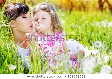 mother with child and dandelion on meadow Stock photo © Paha_L