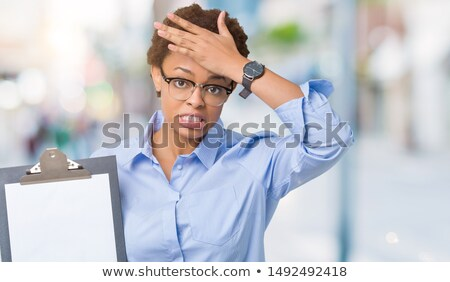 Shocked woman holding clipboard Stock photo © photography33