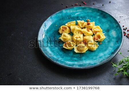 Tortellini paradicsomszósz bazsalikom tányér vacsora paradicsom Stock fotó © ca2hill
