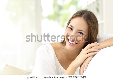 mooie · vrouw · fauteuil · home · portret · thee · vergadering - stockfoto © hasloo